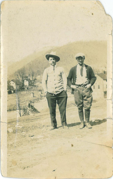 Mike Kundrat (Conrad) and Vasil Youchison standing on what is today Wertz Road with Stone Row in the background, 1927