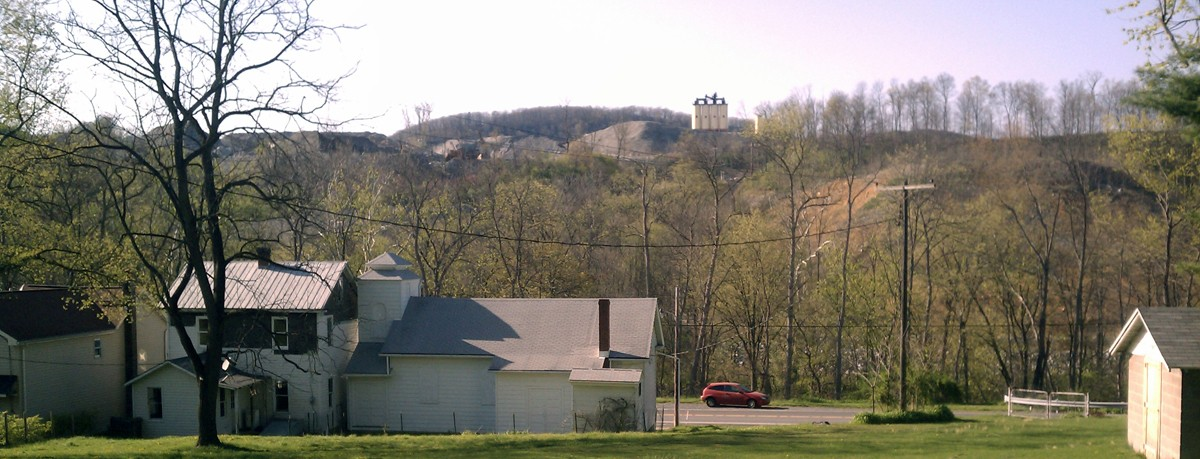Old and new Ganister, the old St. Mary's Orthodox church in the foreground with the new Grannas Brothers quarry in the background